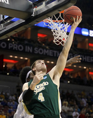 Colorado State University's Hornung fights to get his shot off under pressure from Murray State University's Daniel during the the first half of play in their NCAA basketball game at the KFC Yum! Center in Louisville