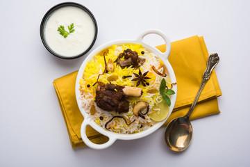 kashmiri or hyderabadi Mutton Gosht Biryani / Lamb Biryani / Mutton Biryani served with Yogurt dip, selective focus