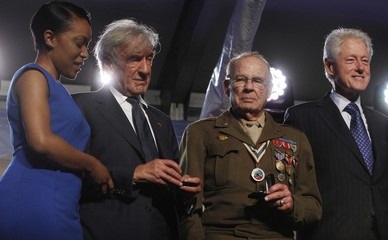 Rebecca Dupas, U.S. Holocaust Museum founding chairman Wiesel, WWII veteran Scottie Ooton and former U.S. President Bill Clinton attend a ceremony commemorating the 20th anniversary of the Museum in Washington