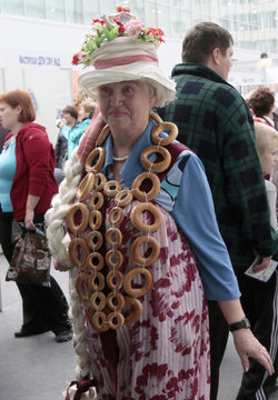 """Participant arrives in fancy dress before mass tea drinking event organised by """"Siberia"""" international exhibition and business centre in Krasnoyarsk"""