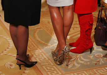 Gabrielle Union wears snake skin shoes as she poses for a picture with Debbie Wasserman Schultz and Frederica Wilson in the audience before Obama honors the 2012 NBA champions, the Miami Heat basketball team in Washington