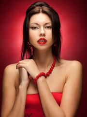 fashion model posing over red background