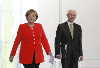 German Chancellor Merkel and  European Council President Van Rompuy arrive for news conference at Chancellery in Berlin