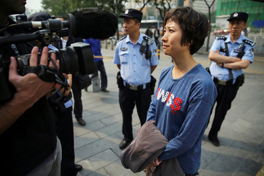Lin Ru, the wife of civil rights lawyer Xia Lin, talks to media in Beijing