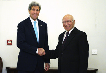 U.S. Secretary of State Kerry shakes hands with Pakistan's National Security Advisor Aziz in Islamabad