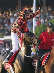 "Jockey Hernan Eduardo Ulloa celebrates atop horse ""Rio Allipen"" upon winning the 131st running of the Derby horse race at Sporting Club in Vina del Mar city, Chile."