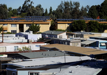 Solar panels are shown at a MASH-funded housing project in National City, California