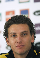 Brazil's national soccer team midfielder Elano listens to questions during a news conference in Johannesburg