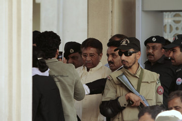 Pakistan's former President Pervez Musharraf leaves after his appearance before the High Court in Rawalpindi