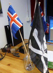 Jolly Rogers pirate flag and Icelandic flags are seen at the Icelandic Pirate Party's headquarters in Reykjavik