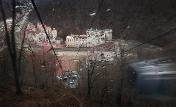 A picture taken through the tinted window of a moving gondola shows the winter sport resort of Rosa Khutor, a venue for the Sochi 2014 Winter Olympics near Sochi