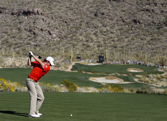 McIlroy of Northern Ireland hits his tee shot on the 15th hole during the quarterfinal round of the WGC Accenture Matchplay Championships golf tournament in Marana