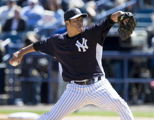 New York Yankees starting pitcher Kuroda works from the mound against the Dominican Republic during the first inning of their baseball exhibition game in Tampa