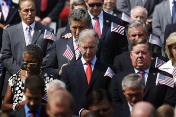 Members of the U.S. Congress bow their heads in prayer during a remembrance of lives lost in the 9/11 attacks, at the U.S. Capitol in Washington