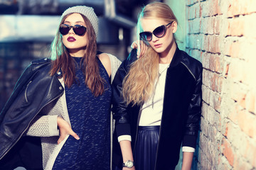 Fashion portrait of two young women in sunglasses.