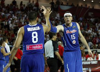 Puerto Rico's Vassallo and Santiago congratulate each other after score against Turkey during their FIBA Basketball World Championship game in Ankara