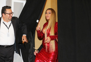 Beyonce arrives in the photo room at the 59th Annual Grammy Awards in Los Angeles