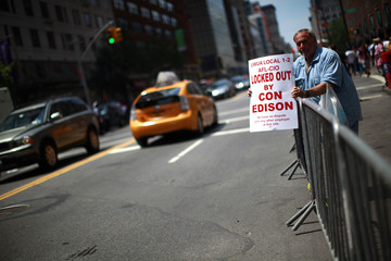 A Consolidated Edison worker protests outside the company's offices in New York