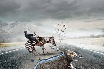 Fototapete - Businesswoman ride zebra