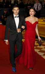 Taiwanese actors Rhydian Vaughan (L) and Cheryl Yang walk on the red carpet upon their arrival at the Asian Film Awards in Macau