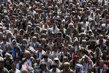 Supporters of Yemeni President Ali Abdullah Saleh perform weekly Friday prayers during a rally held to show support for him in Sanaa