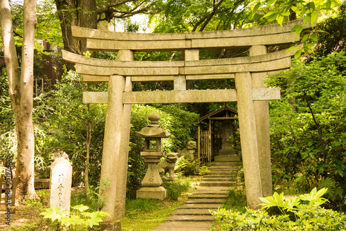 Arched Stone Entrance And A Shrine In A Zen Garden In Japan Stock