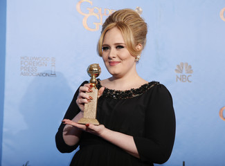 """Adele, winner for Best Original Song - Motion Picture, for """"Skyfall"""" from the film of the same name, poses with her award backstage at the 70th annual Golden Globe Awards in Beverly Hills"""