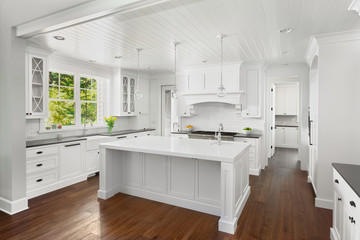 Beautiful White Kitchen in New Luxury Home with Lights Off, no chairs in front of island