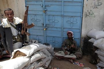 Tribesman loyal to tribal leader Sadeq al-Ahmar secure a street near al-Ahmar's house in Sanaa