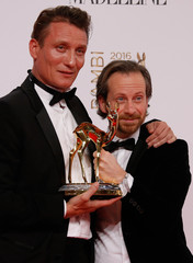 """Busch and Masucci pose with the Best Film National award for their movie """"Er ist wieder da"""" during the Bambi 2016 media awards ceremony in Berlin"""