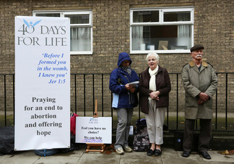 Campaigners from the 40 Days for Life anti-abortion campaign hold a prayer vigil opposite a Marie Stopes family planning clinic in London