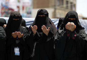 Women pray during a rally to demand the ouster of Yemen's President Ali Abdullah Saleh outside Sanaa University