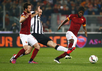 AS Roma's Pjanic and Gervinho challenge Juventus' Chiellini during their Italian Serie A soccer match at the Olympic stadium in Rome