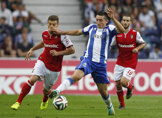 Porto's Herrera fights for the ball with Braga's Tiba and Rafa during their Portuguese Premier League soccer match at the Dragao stadium in Porto