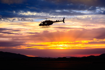 Wall Murals Helicopter Bell 206 at sunset