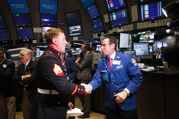 Congressional Medal of Honor Recipient, U.S. Marine Corps Sergeant Dakota Meyer greets a trader at the New York Stock Exchange