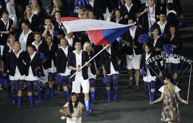 Czech Republic's flag bearer Petr Koukal holds the national flag as he leads the contingent in the athletes parade during the opening ceremony of the London 2012 Olympic Games at the Olympic Stadium
