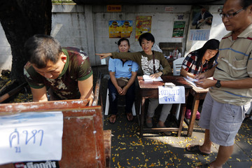 People vote at a mock polling station set up by residents in Rachathewi district, after the actual voting was called off during general elections in Bangkok