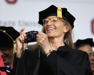 Photographer Annie Leibovitz takes a picture during commencement ceremony at Ohio State University in Columbus