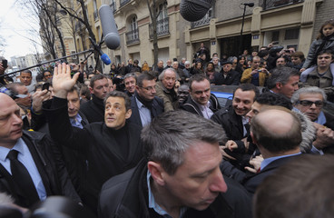 France's President and candidate for the 2012 French presidential elections Sarkozy arrives at his campaign headquarters' inauguration in Paris