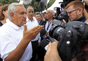 France's UMP party national council vice president and former Prime Minister Raffarin and France's UMP political party leader Cope arrive at the summer meeting of UMP political party in Marseille