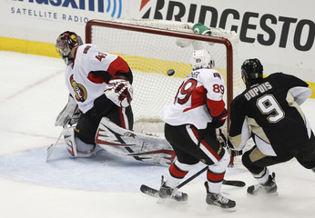 Senators goalie Craig Anderson lets in a goal by Penguins' Crosby during the first period of Game 2 of their NHL Eastern Conference semi-final hockey game in Pittsburgh