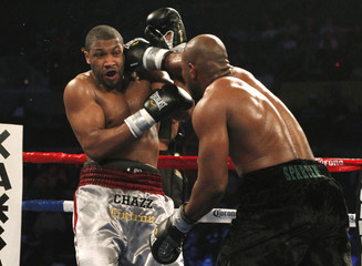 Boxer Mitchell connects to the head of  Witherspoon during the third round of their NABO heavyweight title fight in Atlantic City New Jersey