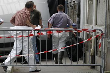 Crime scene investigators work outside the house where human body parts were found in Nantes