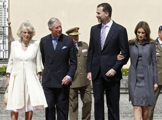 Britain's Prince Charles and his wife Camilla, Spanish Crown Prince Felipe and Princess Letizia pose during a welcome ceremony at the Pardo Palace outside Madrid