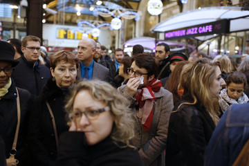 People gather at the Gare de Lyon train station in Paris during a minute of silence for victims of the shooting at the Paris offices of weekly satirical newspaper Charlie Hebdo on Wednesday