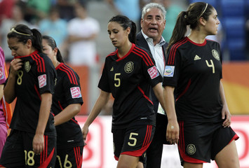 Mexico's players and coach Cuellar react after their Women's World Cup Group B soccer match against New Zealand in Sinsheim
