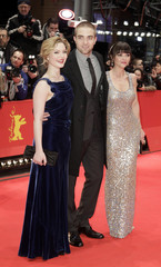 """Cast members Pattinson Ricci and Grainger pose on the red carpet to promote the movie """"Bel Ami"""" at the Berlinale International Film Festival in Berlin"""