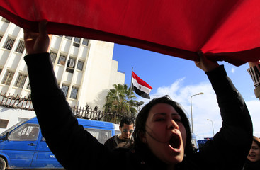 A protester chants slogans during a protest in front of Egypt's embassy in Tunis