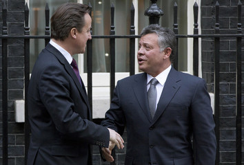 Britain's Prime Minister David Cameron greets King Abdullah of Jordan as he arrives for their meeting at Number 10 Downing Street in London